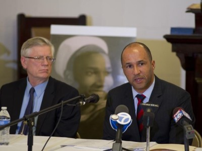 Attorneys Flint Taylor (left) and Michael Laux speak to reporters Tuesday evening.
