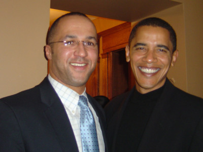 Mike Laux celebrating with then-U.S. Senator Barack Obama at a 2006 holiday party. Throughout the night, Mike urged Senator Obama to run for President.
