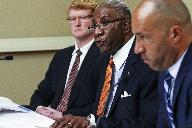 PHOTO BY MITCHELL PE MASILUN Flanked by his lawyers, Pulaski County Circuit Judge Wendell Griffen tells reporters at a Wednesday news conference at Little Rock's Doubletree Hotel that he has filed an ethics complaint against Arkansas Supreme Court justices after they filed a complaint against him this month and removed him from handling any death penalty cases.