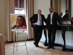 Attorneys Michael Laux, right, Michael A. Kelly stand beside a large photograph of Bobby Moore before a news conference about a federal civil rights lawsuit they filed Monday, June 1, 2015, in Moore's death.