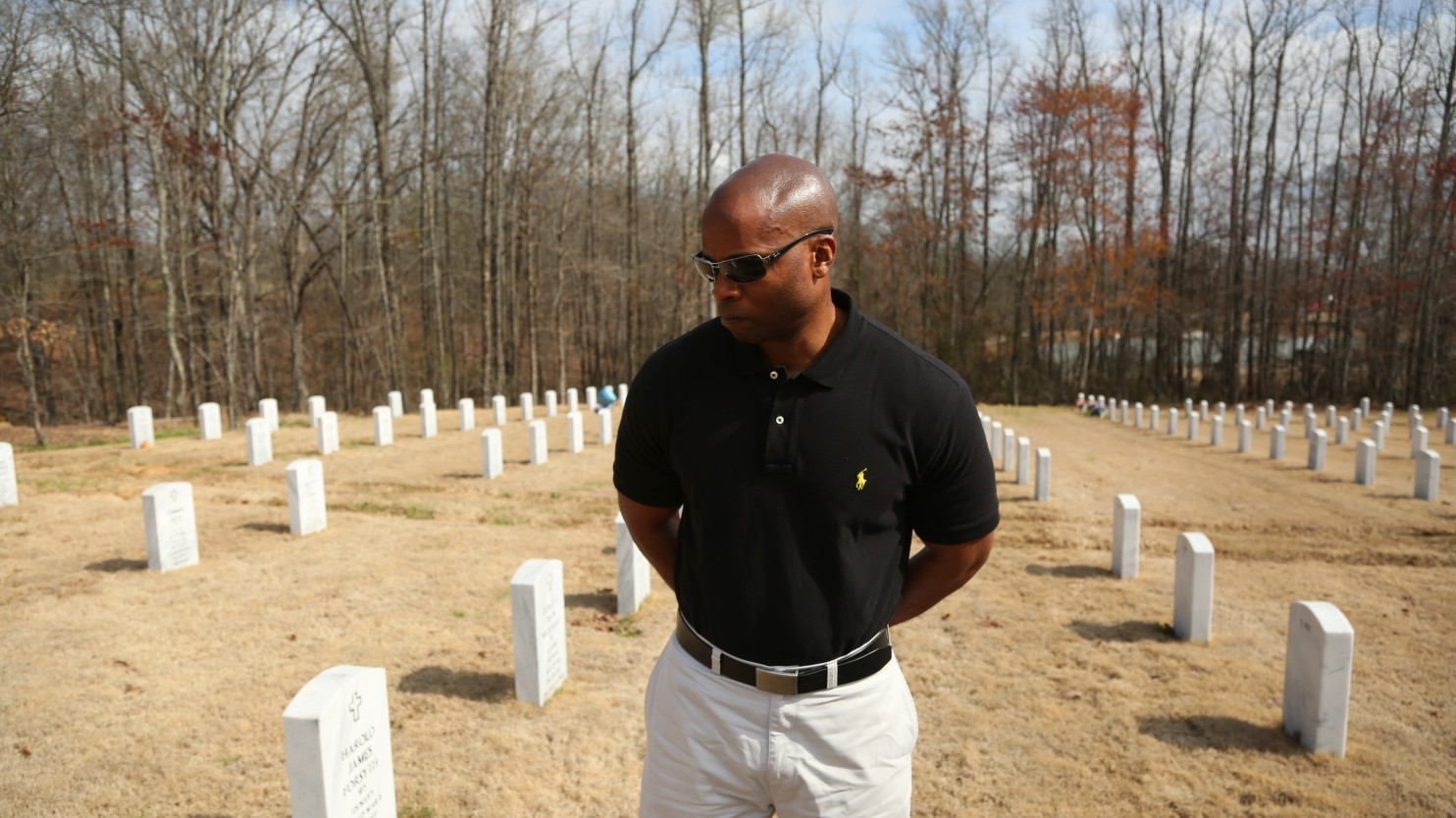 An investigation of the shooting death of 67-year-old Eugene Ellison at the hands of a Little Rock police officer left his sons, including Little Rock police Lt. Troy Ellison, embittered, and with little resolved in the minds of the public. Troy Ellison was photographed at his father's grave March 7. (Whitney Shefte/The Washington Post)