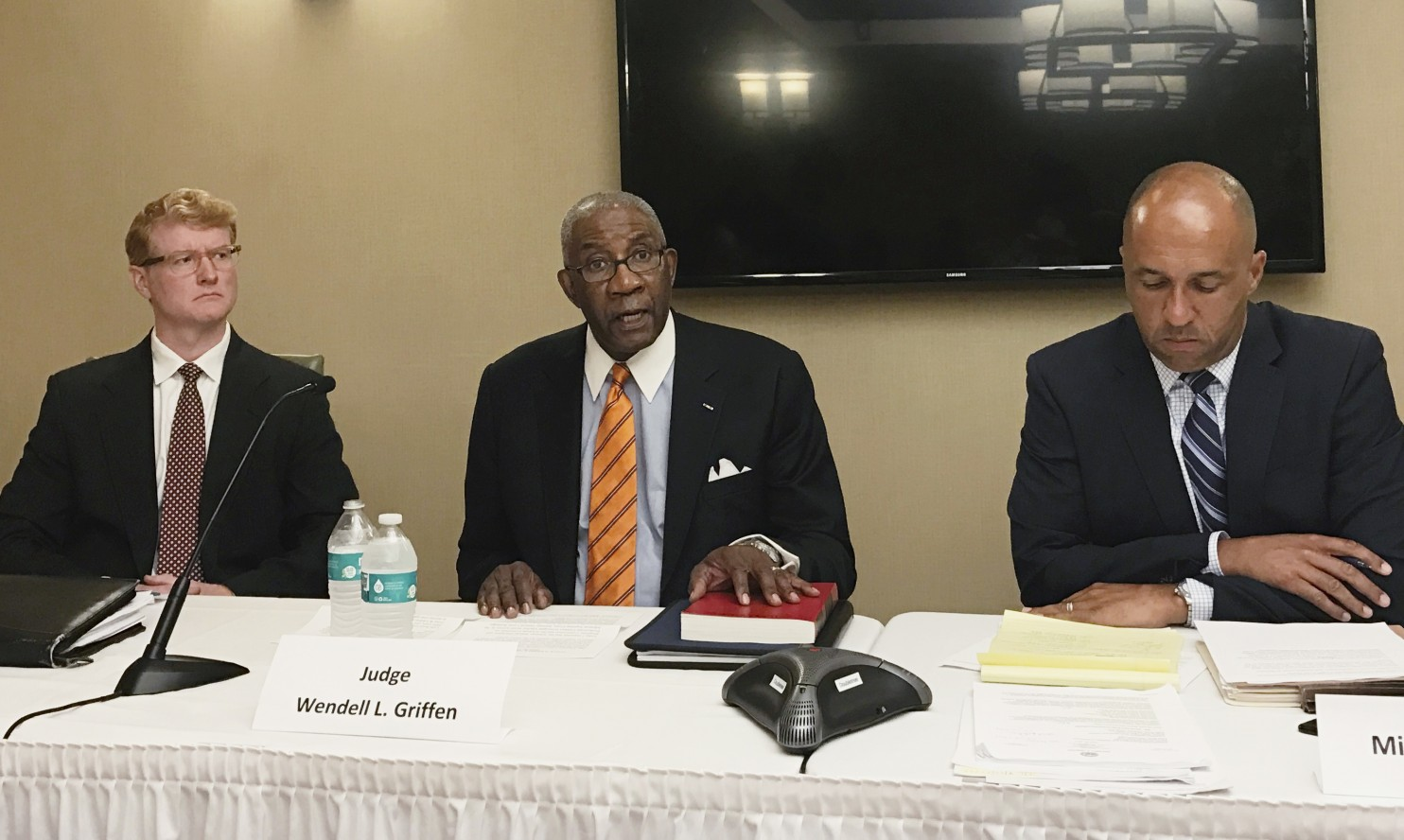 Pulaski County Circuit Judge Wendell Griffen, center, speaks at a news conference Wednesday, April 26, 2017, with his attorneys about a letter he's sent to two panels seeking an investigation into Arkansas' attorney general and Supreme Court over his removal from hearing death penalty cases. Griffen was removed from the cases after he participated in an anti-death penalty demonstration the same day he blocked Arkansas from using a lethal injection drug. (Andrew DeMillo/Associated Press)