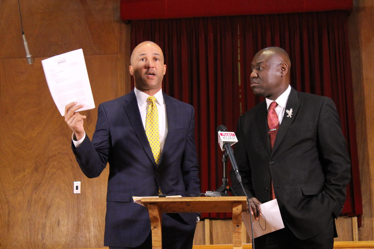 Civil rights attorneys Mike Laux (left) and Benjamin Crump at a press conference in December regarding the Little Rock Police Department's use of no-knock raids. CREDIT MICHAEL HIBBLEN / KUAR NEWS